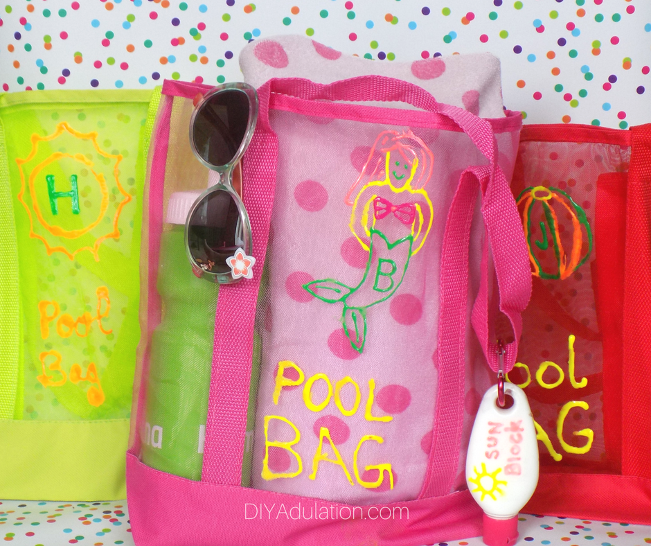 Colorful DIY Summer Pool Bags with Clip On Sunscreen from DIY Adulation.