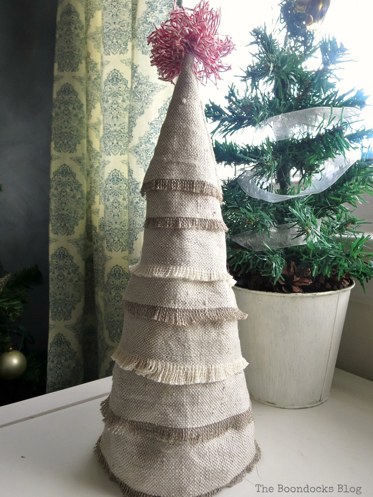 How to Make a Dollar Store Fabric Mini Christmas Tree from The Boondocks Blog.