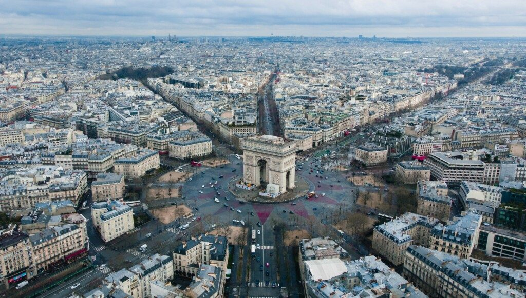 Arc de Triomphe in Paris courtesy Unsplah and Rodrigo Kugnharski.