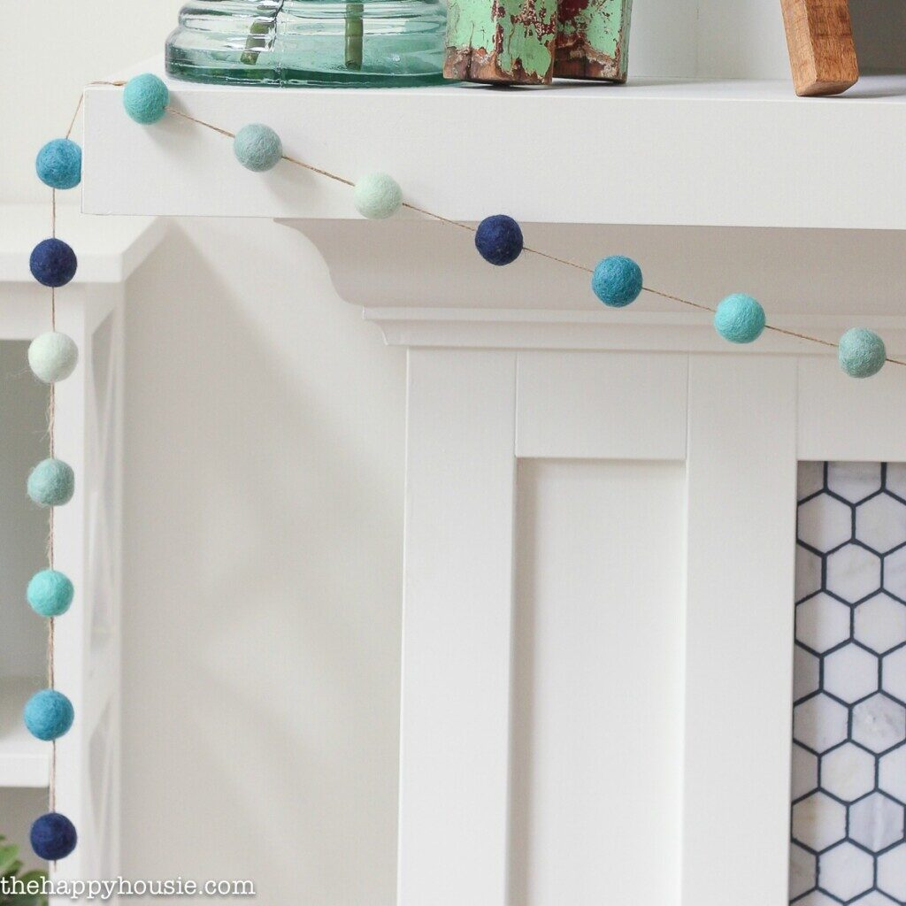 Ombre Beachy DIY Felt Ball Garland from The Happy House.