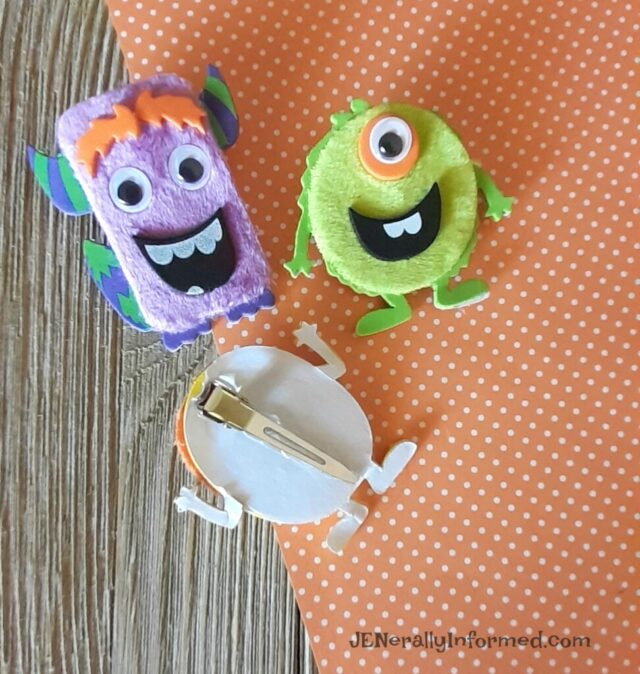 Spooky Halloween hair accessories! Easily make your own fuzzy monster hair clips.