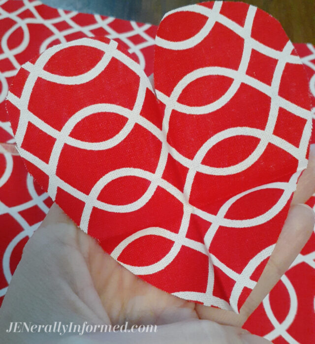 Here's how to make your own super easy Valentine's Day pillow in less than 20 minutes with just a few fabric scraps! #decor #valentinesdaydecor